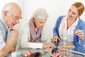 Caregiver assisting seniors in their activity