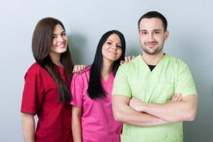 three medical staff smiling